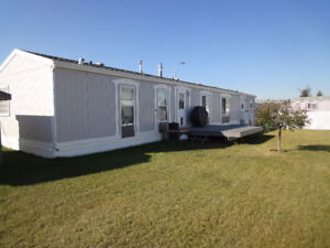 Beautiful mobile on leased lot on the edge of Red Deer!