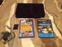 Sony playstation 2 with capcom and taito arcade collections.