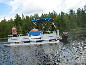20 foot pontoon with a 2001 - 25 HP 2 stroke Johnson