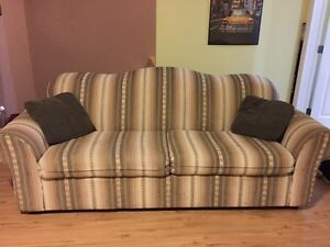 Couch for sale - stored in garage ready for pick ip