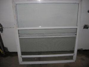 2  Aluminium storm windows 35 ¾`` W x 38``H    25.00 each Cornwall Ontario image 2