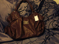 Coach purse with tag on it