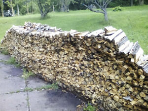 FIRE WOOD CUT AND SPLIT $ 80.00 HALF TON TRUCK LOADS ROADSIDE