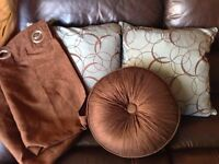 Blue and brown pillows and curtains
