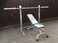 7ft OLYMPIC BARBELL, YORK FITNESS ADJUSTABLE WEIGHTS BENCH AND MARCY BENCH PRESS STANDS