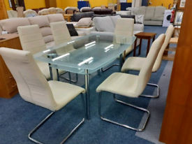 Glass top dining table with 6 chairs