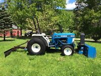 1993 New Holland Ford tractor and implements.