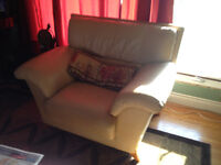 2 leather chairs and couch