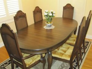 Solid oak dining room table, chairs, hutch and buffet