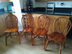 4 Wheel Back Chairs in excellent used condition