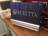 Beretta gun shop sign