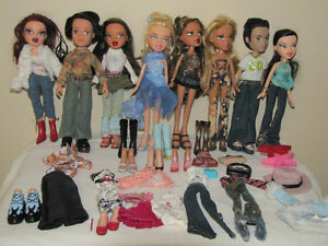 FOR SALE A LOT OF 8 BRATZ DOLLS WITH EXTRA CLOTHES & ACCESSORIES