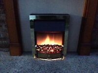 Electric flame effect fireplace and surround