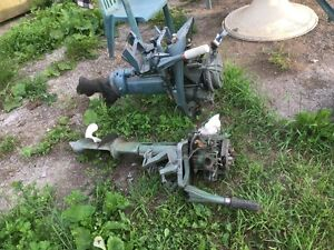 Two old boat motors for parts