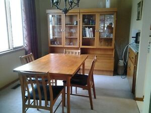 Teak dining room table, chairs and china cabinets