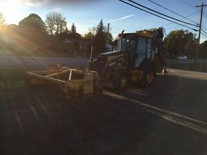 2009 Deere 310 SJ Backhoe with Snow Pusher