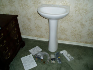Brand new pedestal sink, taps and all fittings