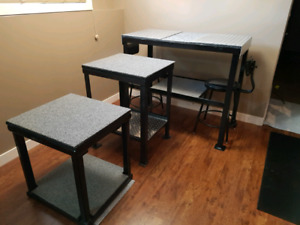 3 metal work benches and two stools.