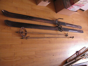 2 pairs of antique wood skis and 1 set of poles