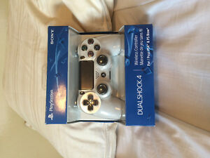 Brand new white ps4 controller still in box