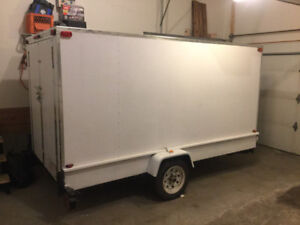 5' by 10' enclosed trailer.