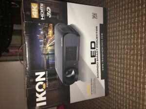 SELLING BRAND NEW IN BOX IKON LED ANDROID SMART PROJECTOR 4K 3D