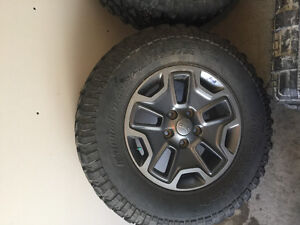 2 factory jeep rims with tires