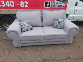 Brand new ex display 2 seater sofa with chesterfield arms £245