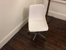 White plastic swivel chair