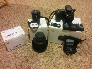 Mirrorless Nikon 1 V2 w/ 4 lenses, 5 batteries.