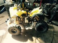 Yellow 115cc atv