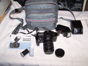 Canon EOS 630 35mm camera with zoom lens and flash