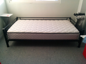 Black metal bed and single mattress