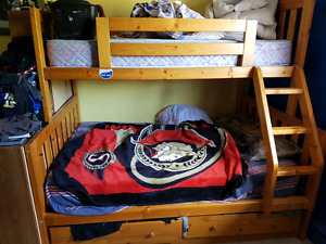 Double bunk bed with single top and captains drawers beneath.