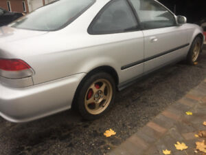 2000 SI civic parting out let me know what part you need