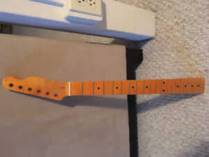 22 fret maple telecaster style neck in vintage amber finish