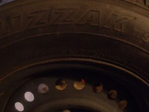 4 used Blizzak winter  tires mounted on steel rims (Ford)