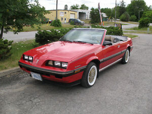 An EXCELLENT 1984 Sunbird Convertible. Newer roof, Good body.