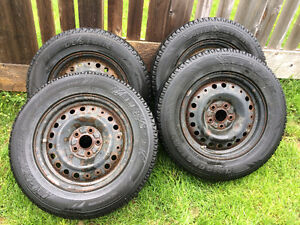 215/70R16 - Four Bridgestone Blizzak Tires on Rims