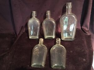 Vintage glass whiskey flasks (5)