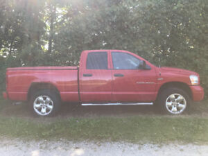 trade a 2006 Dodge Ram 4x4 for a good working riding lawnmower