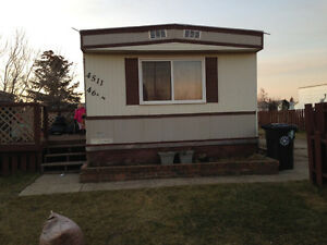 Mobile home on owned lot in Rycroft