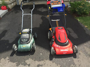 2 battery operated lawnmowers