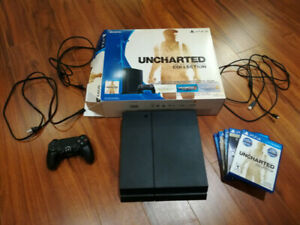 Great condition PS4, 25 games, controller, and fps Strikepack