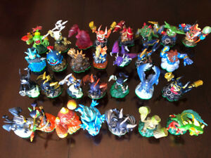 ABOUT 125 SKYLANDER FIGURES! 2 GAMES, 2 PORTALS, CARDS, CASE