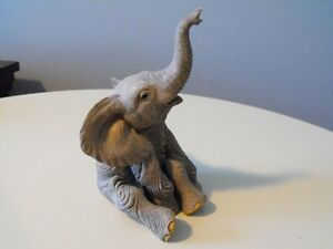 COLLECTIBLE TUSKERS FIGURINE  LOUIS