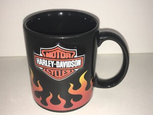 a black colored harley davidson coffee mug with flames