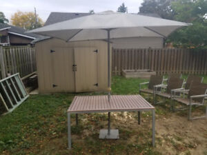 Used 6-seat Gluckstein patio set with umbrella