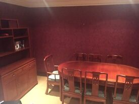 Oriental rosewood dining room set. Table and 8 chairs plus sideboard