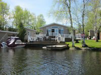 LAKEFRONT HOME/COTTAGE FOR SALE 199 LEFEBVRE PENINSULA  REMI LAK